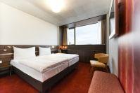Simm's Hotel, Wien - hellgrau und orange dominieren