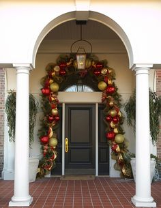 Door Garland with evergreens, deco mesh and oversized ornaments