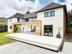 Love the combo of render and wood cladding