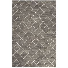 """Jaipur's Riad collection calls on classic Moroccan berbers for stylish inspiration. The Gem rug presents a timeless lattice pattern, wavering slightly with an authentic tribal air. The plush construction impresses in wool. Available in Charcoal Gray and Blue Ashes; Colors noted are Pantone TPX; 100% wool; Vacuum regularly; professional cleaning recommended; 2'W x 3'L; 4'W x 6'L; 5'W x 8'L; 8'W x 10'L; 9'W x 12'L; 9'6""""W x 13'6""""L"""