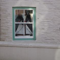 Pretty window, whitewashed house in Cornwall