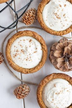 Eggnog Cheesecake Cookie Cups! Chewy gingerbread cookie cups filled with a fluffy eggnog cheesecake. | livforcake.com