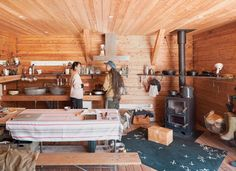 """A PLATFORM FOR LIVING  Setsumasa and Mami Kobayashi's weekend retreat, two and a half hours northwest of Tokyo, is """"an arresting concept,"""" photographer Dean Kaufman says, who documented the singular refuge in the Chichibu mountain range. """"It's finely balanced between rustic camping and feeling like the Farnsworth House.""""  http://www.dwell.com/house-tours/article/platform-living"""