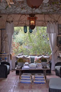 loggia and lanterns - for people like us, in the city, this would be a great idea for giving a view a country feel in the summer rather than seeing houses, cars, etc. out your window.