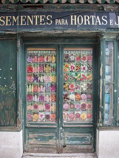 Doorway with floral curtains.  Portugal
