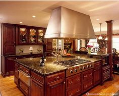 BEAUTIFUL Island design. I don't necessarily care for the stove on the island, but the size and granite is great