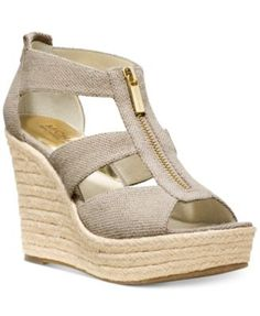 """MICHAEL Michael Kors Damita Platform Wedge Sandals: The height of fashion... these platform sandals are the ultimate summer wedge. The heel is the perfect height and the lightweight leather comes in four super cute colors. The zipper detail along the front provides the chic and glamorous touch that Michael Kors is known for. Round open-toe platform wedge sandals with zipper closure on front. 3-3/4"""" espadrille wedge heel, 1"""" platform, feels like 2-3/4"""" heel. Fabric upper, manmade sole. 5,5…"""