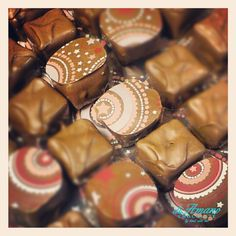 Champagne Truffle - This timeless chocolate truffle is one of our most popular selections.  The center consists of a champagne infused dark chocolate ganache, which is then dipped into our creamy milk chocolate to produce a rich and delicious taste. From diAmano Chocolate in Atlanta.