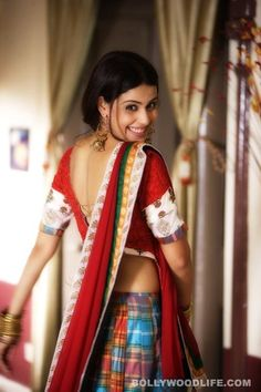 Not a saree but how can you pass up that gorgeous smile Genelia D'Souza bollywood saree