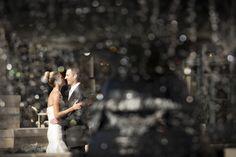 Fountain view of bride and groom, photo by Beau Petersen Photography   via junebugweddings.com