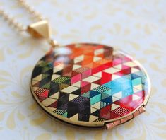 Graphic locket necklace.