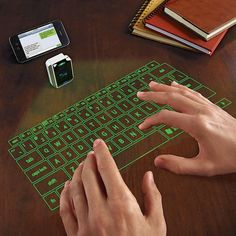 Laser Projection Virtual Keyboard Put the future at your fingertips with our virtual laser keyboard. Revolutionary laser technology projects a virtual keyboard on any flat surface! Gadgets And Gizmos, Electronics Gadgets, Iphone Gadgets, Latest Gadgets, Travel Gadgets, Top Gadgets, Cool Tech Gadgets, Useful Gadgets, Future Gadgets