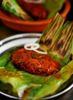 A kerala fish delicacy where fish covered in masalaand wrapped in banana leaves and slow cooked.