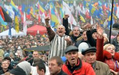 More than Ukrainians marched against a decision by President Viktor Yanukovych's government to cut off preparations for a free-trade pact with the European Union and seek closer ties with Russia. Ukraine, Russia, Free