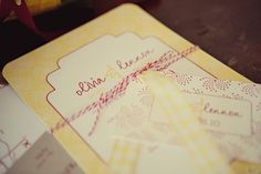 Baker's twine around invitations is always a nice touch. Photo by Krystal Mann #weddinginvitations #cedarwoodweddings