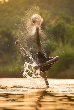 Full Power Shooting !!!! - Local Soccer player with ball in action outdoors.Splashing water.