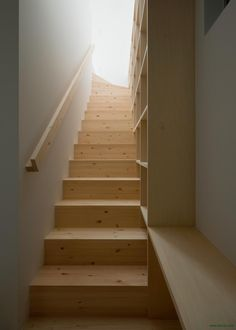 Creative Idea To Accompany Indoor Staircase Featured With Simple Wooden Railing With Open Shelving Attached On Right Wall