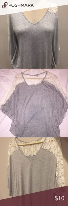 Gorgeous Gray and Lace Top by Red Haute Gorgeous gray and lace top. This has been previously worn a few times, but it great condition! Very flattering. Let me know if you have any questions! Red Haute Tops Blouses