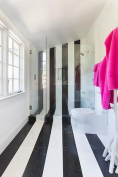 Contemporary kid's bathroom features black and white marble stripe floors which seamlessly continues to the walk in shower. Contemporary kid's bathroom features black and white marble stripe floors which seamlessly continues to the walk in shower. Childrens Bathroom, Kid Bathroom Decor, White Bathroom, Small Bathroom, Pink Striped Walls, Striped Room, Black And White Flooring, Black And White Marble, Marble Interior