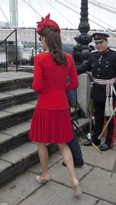 The Queen's Diamond Jubilee was one of the best bank holidays ever. London was littered with special pop-up events and street parties, with the official three days of celebrations including a flotilla, a concert, and then the Royal Family balcony wa ve with an RAF fly over included.Read more at http://www.thefashionspot - Kate Middleton Stuns in Red With William, Harry and the Middletons For the Diamond Jubilee