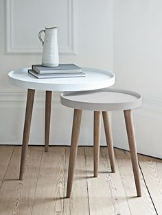 £95 With three Scandinavian style white cedar legs and a smooth modern painted lipped top, our Lina Side Tables are finished in two complementary shades, the larger a light powder blue and the smaller a soft grey blue. Use alone as a stylish side table or nest together to make a statement in your living space. Also available in two blush shades here, and two grey colours here.