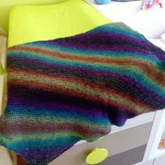 Magical Rainbow Baby Blanket | A knit baby blanket in an array of beautiful colors. Perfection!