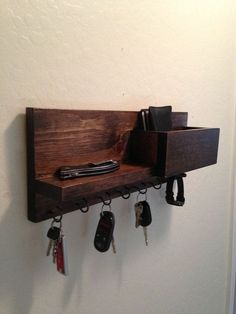 This is a key hook holder organizer for your mail, keys jewelry and most anything you need to keep organized. size - 16 L x 6 T x 4 deep this one is pine with dark walnut stain has 6 hooks and a dowel for your watch or bracelet necklace or ? Bracelet Organizer, Key Organizer, Bracelet Holders, Necklace Holder, Mail Organizer Wall, Wall Key Holder, Key Holders, Wooden Key Holder, Diy Key Holder
