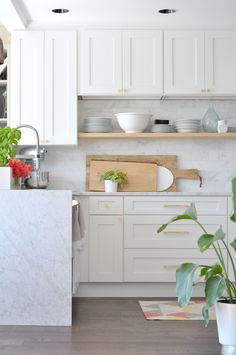white and wood kitchen - and those cutting big cutting boards!