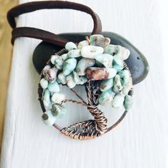 A personal favorite from my Etsy shop https://www.etsy.com/listing/271380533/larimar-bead-wire-wrapped-copper-tree-of