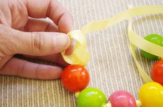 How to Make a Gumball Necklace - This is a perfect treat for a Candyland themed party & also a cool party activity.