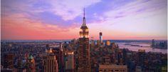 Vue d'un coucher de soleil en haut d'un gratte ciel à New-York