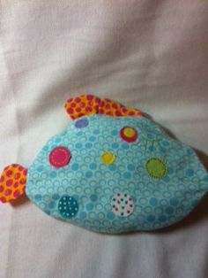 Our newest product...Tummyroo's!! Meet Bubbles the Fish!  Custom designed buckwheat seed heat bags for infants, toddlers and children. Check them out!! Elephants, Pigs, Turtles, Alligators and Fish! For tummy aches, colic, bumps, bruises, hurt feelings, keeping toddlers in their own beds and just plain old warm and toasty comfort!!