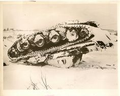 Overturned German Tank In Belgium Snow This overturned German tank rests in the snow in the area between Grandmenil and Houffalize, in Belgium, where it was knocked out by the advancing British forces.