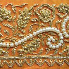 Bordado en canutillos y perlas