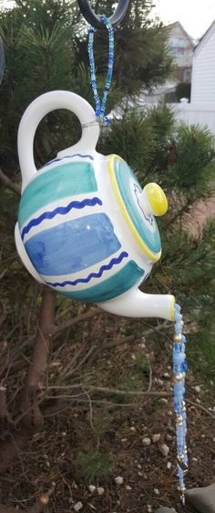 Check out this item in my Etsy shop https://www.etsy.com/listing/501592357/re-purposed-whimsical-teapot-sun-catcher