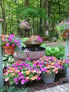 Water fountain and flowers in half barrel