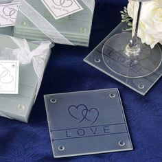 Heart Glass Coaster - Set of Four | eFavorMart / Coasters are the most popular favor idea these days that combine the convenience of being efficiently purposeful with their contemporary stylish look that they impart to any banquet table. These coasters are modish as well as useful. Our frosted glass coasters have a very charming double heart image with a Love note that makes them extra heart-touching. These classic heart coasters will add a dash of modern touch into your Champagne party, Bar…