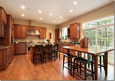 Warm neutrals, such as Benjamin Moore Powell Buff and Monroe Bisque will work well.oak cabinets