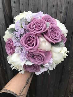 Wedding bouquet of white peony, Cool Water roses, Apple Blossom Stock and dusty miller.
