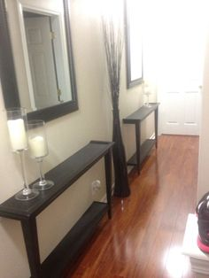 Narrow hallway decor solution! Cut a table in half and bolt to the wall!! Use mirrors to give it a larger space feel! by shannon