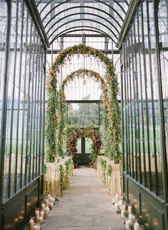 Garland arches via Honey of a Thousand Flowers