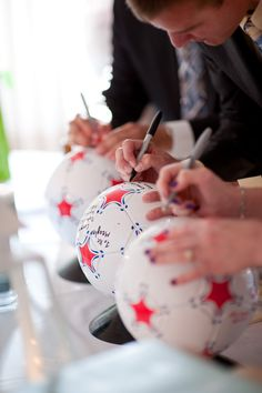 wedding guest book= soccer balls Again this is gonna be at my wedding!!!