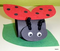 Ladybug craft - round paper, oval face, wings, bobble eyes and pipe cleaners