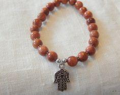 bracelet perles bois perle gemstone Bracelet perles naturelles en bois BRACELET : - bracelet monté sur élastique extensible - taille : vous pouvez