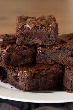 Crazy good brownies! Seriously though, these thick, dense brownies are packed full of three kinds of chocolate and baked to perfection. People have told me these are the BEST they've ever had!