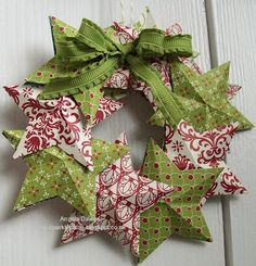 Festival of Prints - this is a good idea to recycle old Christmas cards. Make a star template, score and fold them to make them 3D