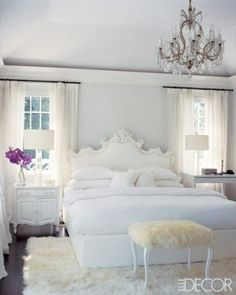 Love the white. Complete with a chandelier.