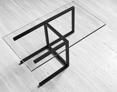"""Arquétipo, coffee table"" by Enrico Salis. Steel structure and glass."