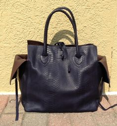 Let & Her pressed leather handbag from Israel-$848