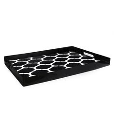 This rectangular serving tray is made of polypropylene and has a lattice design reminiscent of Moorish design.